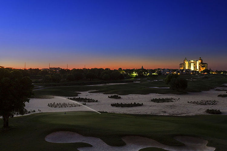 Sunset of Reunion Resort, Arnold Palmer Course, and the Grande